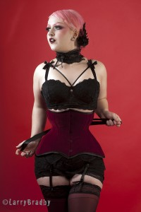 Gothic Anachronist in a red velvet underbust