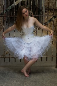 Model in White Overbust Corset at Penitentiary Gate